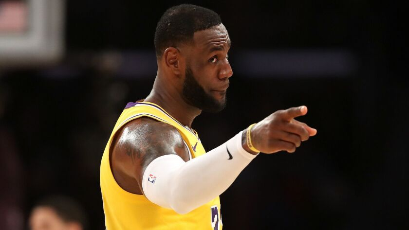 """LeBron James points out that, with several players the Lakers have to rely on still early in their careers, """"we have to understand ... they're going to make mistakes."""""""