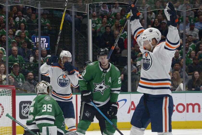 Edmonton Oilers right wing Alex Chiasson, right, and center Connor McDavid (97) celebrate a goal as Dallas Stars goaltender Anton Khudobin (35) and defenseman Esa Lindell (23) react during the second period of an NHL hockey game in Dallas, Tuesday, March 3, 2020. (AP Photo/Matt Strasen)