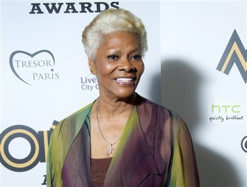FILE - This Nov. 3, 2012 file photo shows singer Dionne Warwick after receiving the lifetime achievement award at the 2012 MOBO Awards in Liverpool. The music industry's largest record companies are suing Sirius XM Radio for royalties it says the satellite radio company didn't pay for recordings from before 1972. Sony, Universal and Warner, as well as ABKCO, an independent company that manages the music rights of acts like the Rolling Stones and The Animals, filed the lawsuit Wednesday, Sept. 11