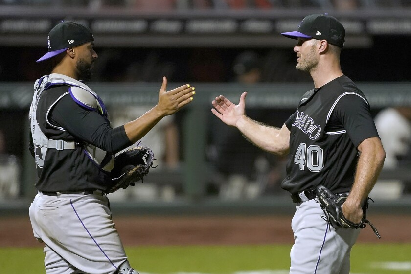 Colorado Rockies relief pitcher Tyler Kinley (40) is congratulated by catcher Elias Diaz after the final out of the ninth inning in a baseball game against the San Francisco Giants on Monday, Sept. 21, 2020, in San Francisco. Colorado won 7-2. (AP Photo/Tony Avelar)