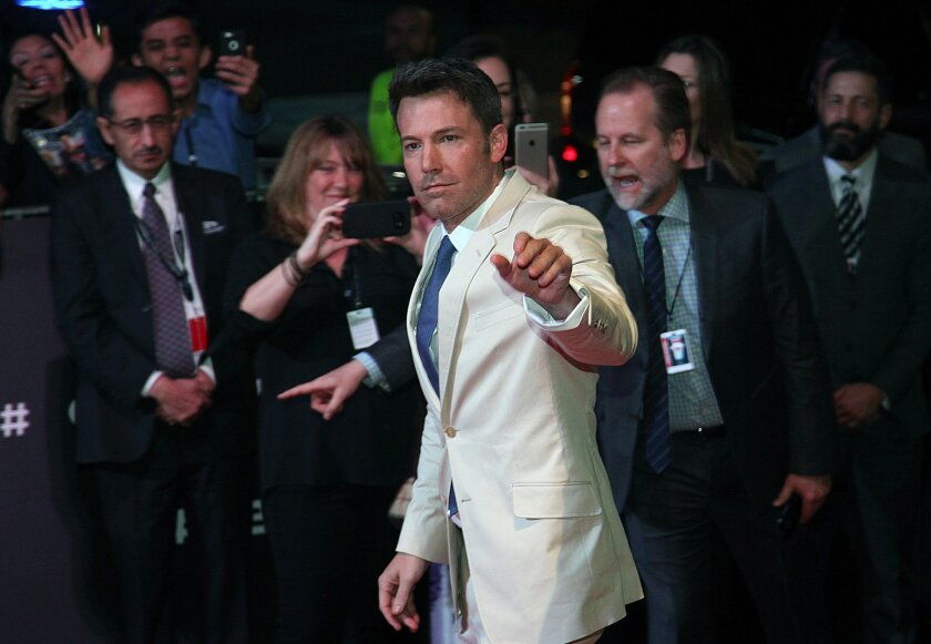 "U.S. actor Ben Affleck, cast as Batman, waves as he arrive for the red carpet event promoting ""Batman v Superman: Dawn of Justice"", at the Auditorio Nacional in Mexico City, Saturday, March 19, 2016. (AP Photo/Marco Ugarte)"