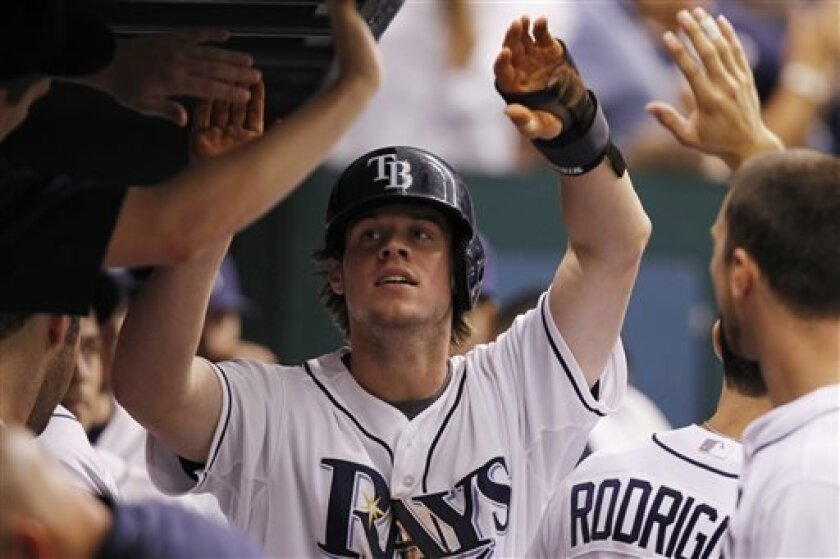 Tampa Bay Rays' Wil Myers celebrates with teammates in the dugout after scoring a run during the six inning of a baseball game against the Houston Astros, Saturday, July 13, 2013, in St. Petersburg, Fla. (AP Photo/Scott Iskowitz)