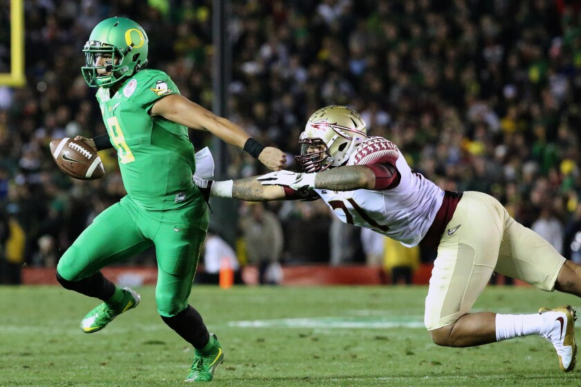 Florida State defensive end Chris Casher can't catch Oregon quarterback Marcus Mariota on his touchdown run in the fourth quarter.