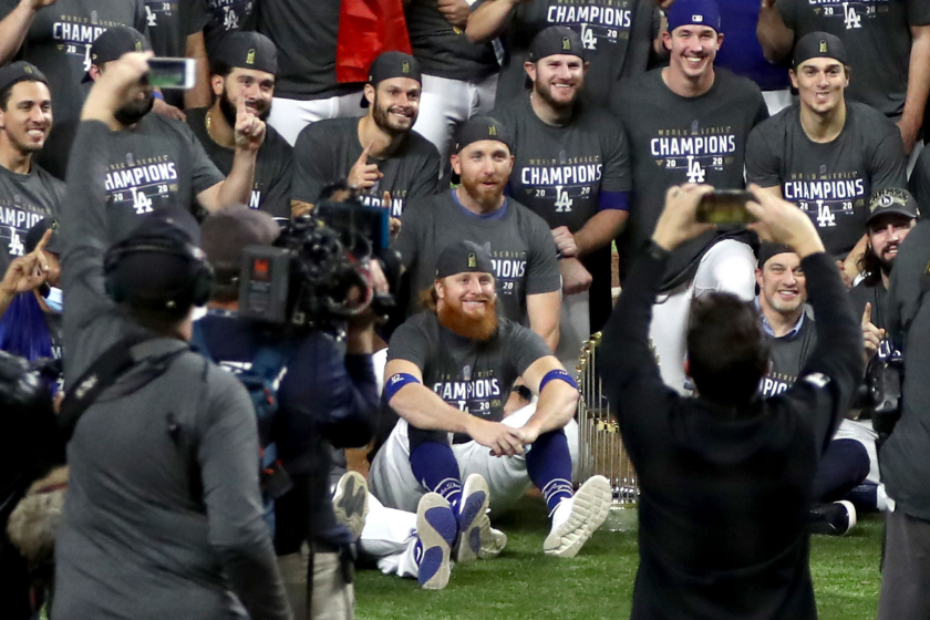 Justin Turner, front row center, poses with the Dodgers after Game 6 of the World Series