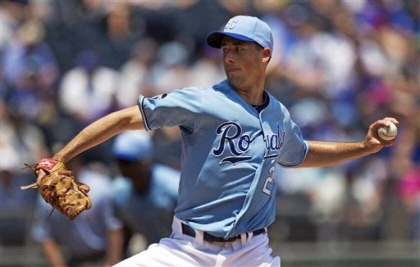 Kansas City Royals starting pitcher Jeff Francis throws against the Minnesota Twins in the first inning of a baseball game, Sunday, June 5, 2011, in Kansas City, Mo. (AP Photo/Charlie Riedel)