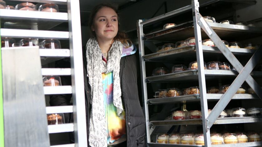 Laura Pekarik, owner of Cupcakes for Courage, stands amongst her cupcakes in her food truck after th