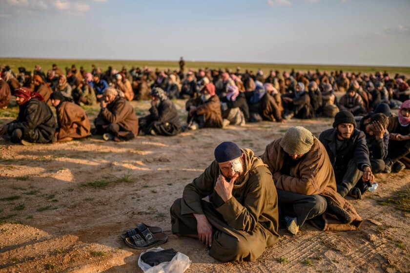 Suspected Islamic State fighters wait to be searched by members of the Kurdish-led Syrian Democratic Forces after leaving Islamic State's last holdout, Baghouz, in Syria's Dair Alzour province on Feb. 22, 2019.