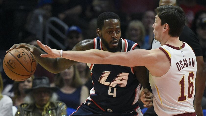 Los Angeles Clippers forward JaMychal Green, left, posts up against Cleveland Cavaliers forward Cedi