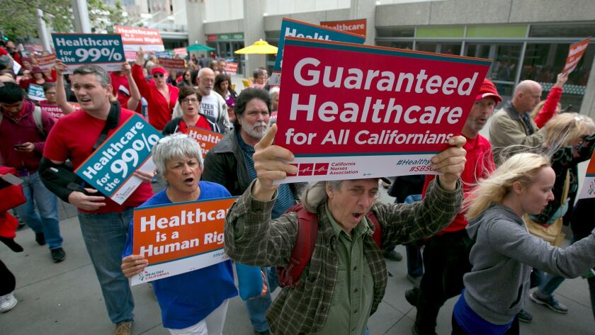 Supporters of single-payer healthcare march to the state Capitol on April 26 in Sacramento.