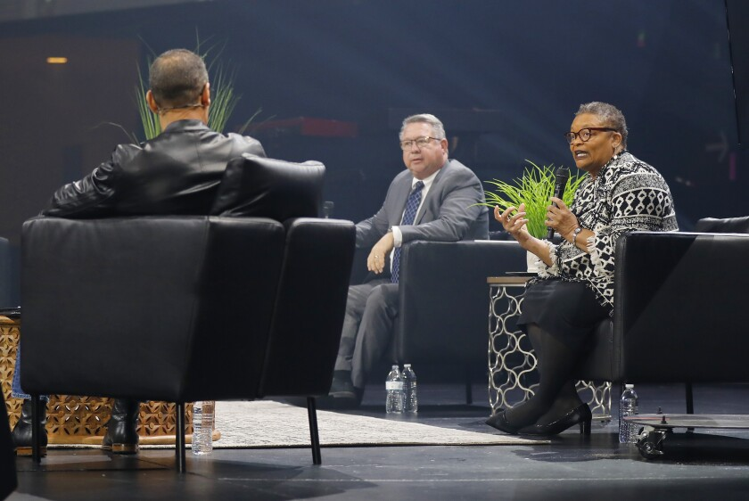 Dr. Wilma Wooten, San Diego County's public health officer, right, was interviewed by Pastor Miles McPherson, left, during a service at the Rock on March 15, 2020. El Cajon Mayor Bill Wells looks on.