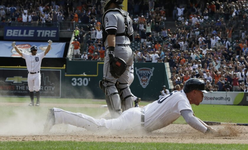 Detroit Tigers' JaCoby Jones slides in for the game-winning run in the ninth inning of a baseball game against the Chicago White Sox, Wednesday, Aug. 31, 2016, in Detroit. The Tigers won 3-2. (AP Photo/Carlos Osorio)