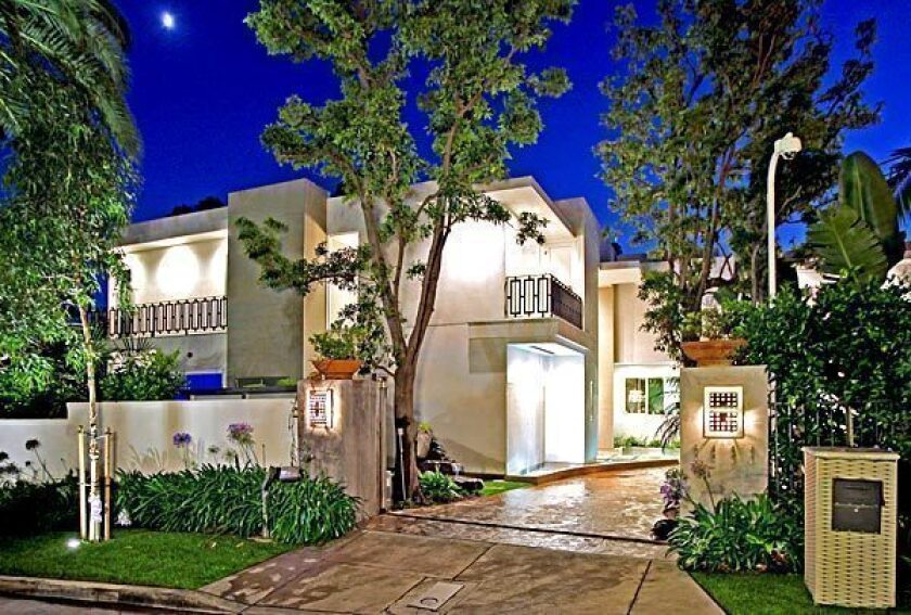 The gated contemporary in West Hollywood is listed at $15 million.