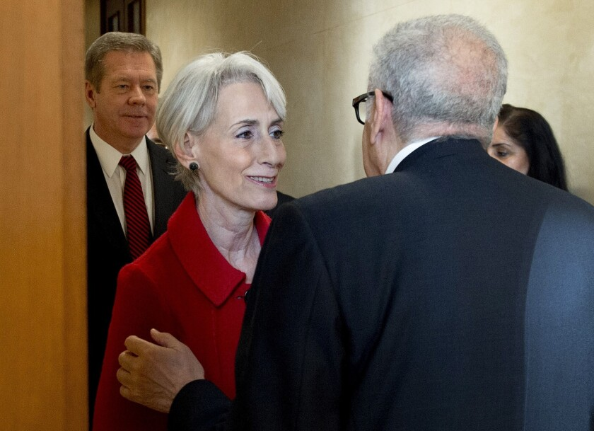 U.N. special envoy to Syria Lakhdar Brahimi, right, welcomes U.S. Undersecretary of State Wendy Sherman and Russian Deputy Foreign Minister Gennady Gatilov, left, at the United Nations office in Geneva on Monday, prior to a meeting on talks aimed at seeking a negotiated solution to the Syrian conflict.