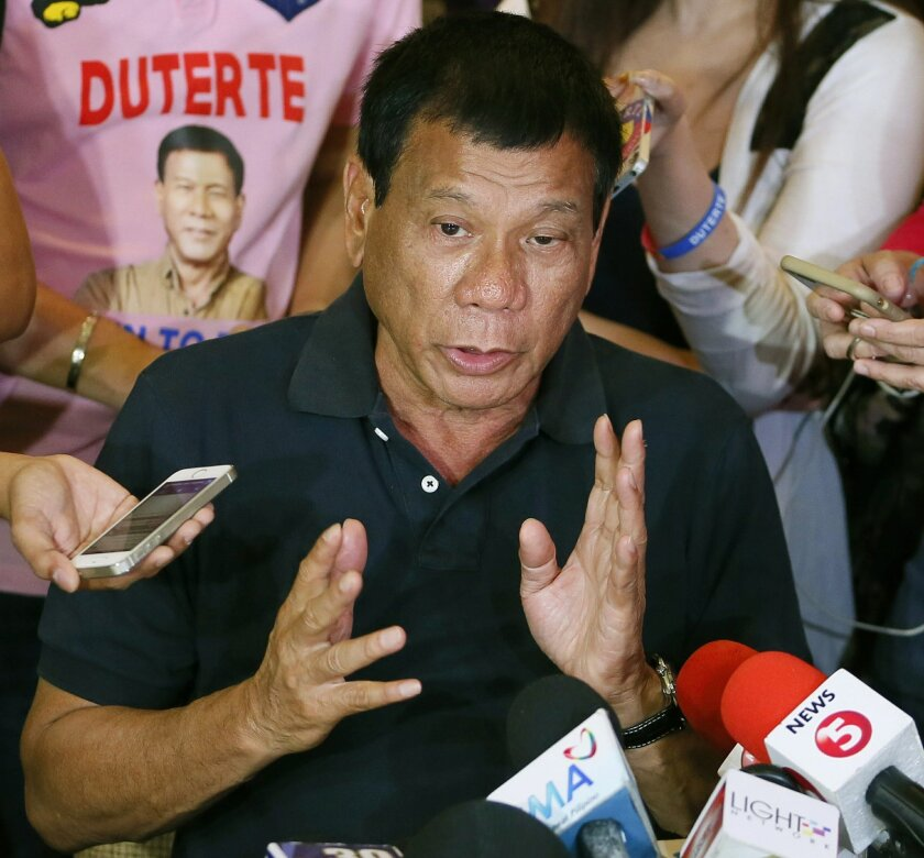 FILE - In this April 29, 2016 file photo, presidential candidate Rodrigo Duterte answers questions from the media in Manila, Philippines. The Philippine president-elect encouraged the public to help him in his war against crime and urged citizens with guns to shoot and kill drug dealers who would r