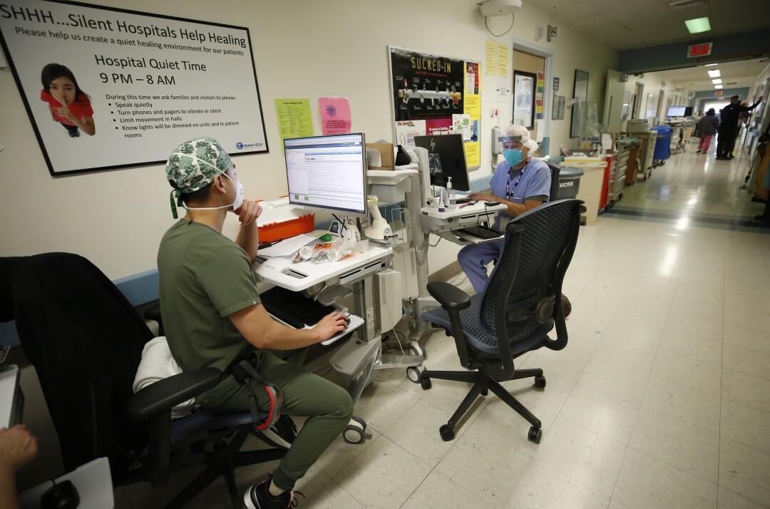Two nurses at desks in Harbor-UCLA Medical Center.