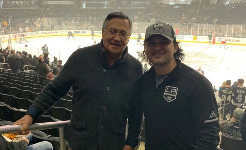 Jaime Jarrin and his grandson Stefan Jarrin pose for a photo before a game at Staples Center.