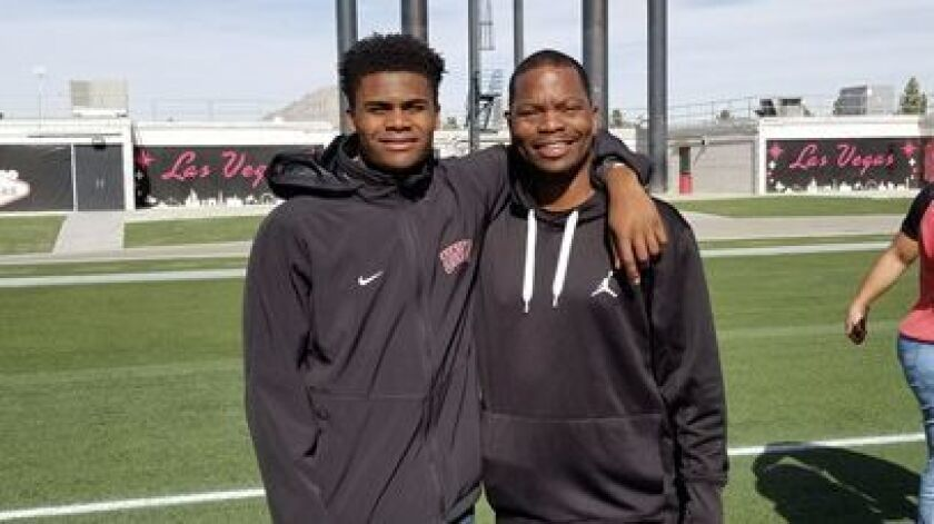 Left to right . John Jackson III (current freshman WR) and his dad John Jackson Jr. (former USC WR