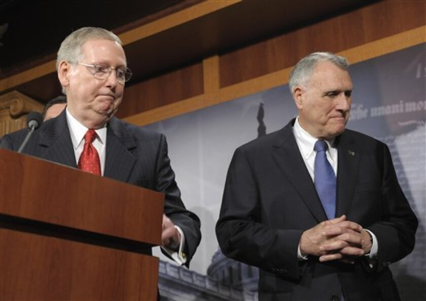 Senate Minority Leader Mitch McConnell of Ky., left, and Senate Minority Whip Jon Kyl of Ariz., leave after a news conference on Capitol Hill in Washington, Tuesday, July 12, 2011. (AP Photo/Susan Walsh)