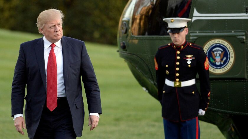 epa05900603 US President Donald J. Trump walks on the south Lawn after arriving at the White House i