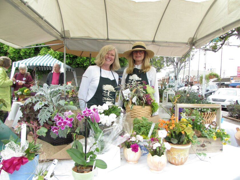 Kathy Easterbland and Ann Miller help out at La Jolla Garden Club's 38th annual Flower Market, May 7.