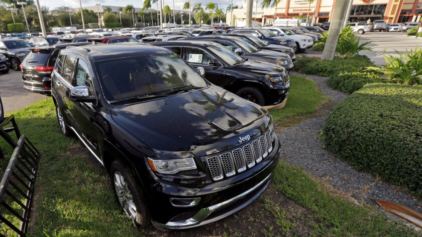 2015 Grand Cherokees are displayed at a Fiat Chrysler dealership in Doral, Fla., in November.