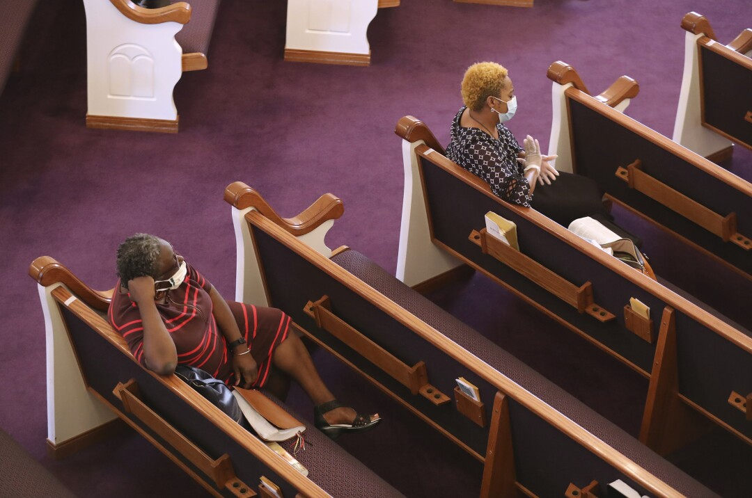 GEORGIA: Church members practice social distancing and wear masks while attending the Palm Sunday praise and worship service at Union Springs Baptist Church on Sunday in Rutledge, Ga.