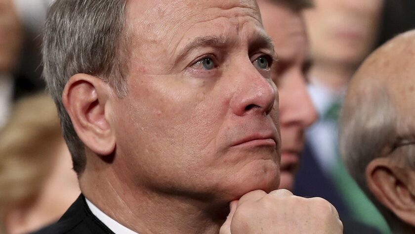 FILE - In this Tuesday, Jan. 30, 2018 file photo, U.S. Supreme Court Chief Justice John Roberts list