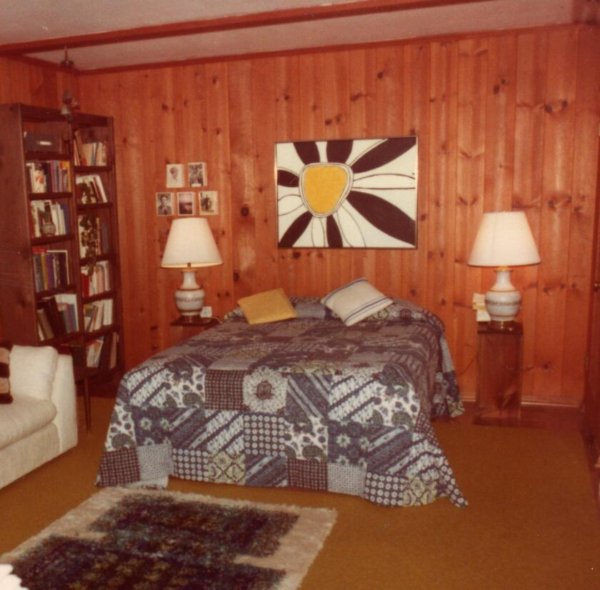 While going through a photo album recently, I came across a picture of our guest room in 1977 with the daisy picture hanging over the bed.