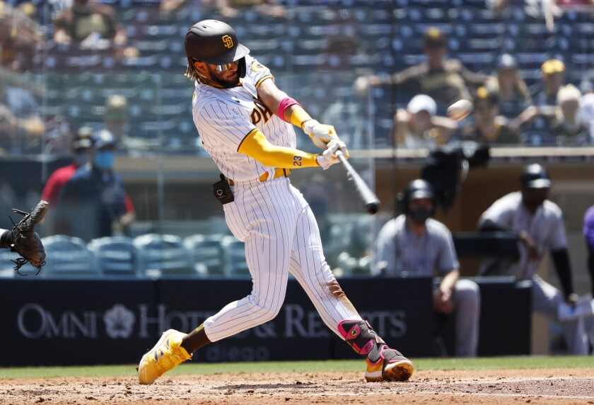 Fernando Tatis Jr. hits a home run in the fourth inning against the Colorado Rockies on Wednesday at Petco Park.