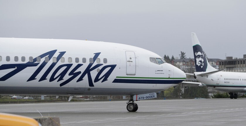 Alaska Airlines faces outrage from people on social media after a gay couple had to give up seats on a New York City-Los Angeles flight to make room for a straight couple. The Seattle Times reports the couple accepted an apology Tuesday from the airline, which said there was a seating mistake not reflective of disrespect in Sunday's incident.