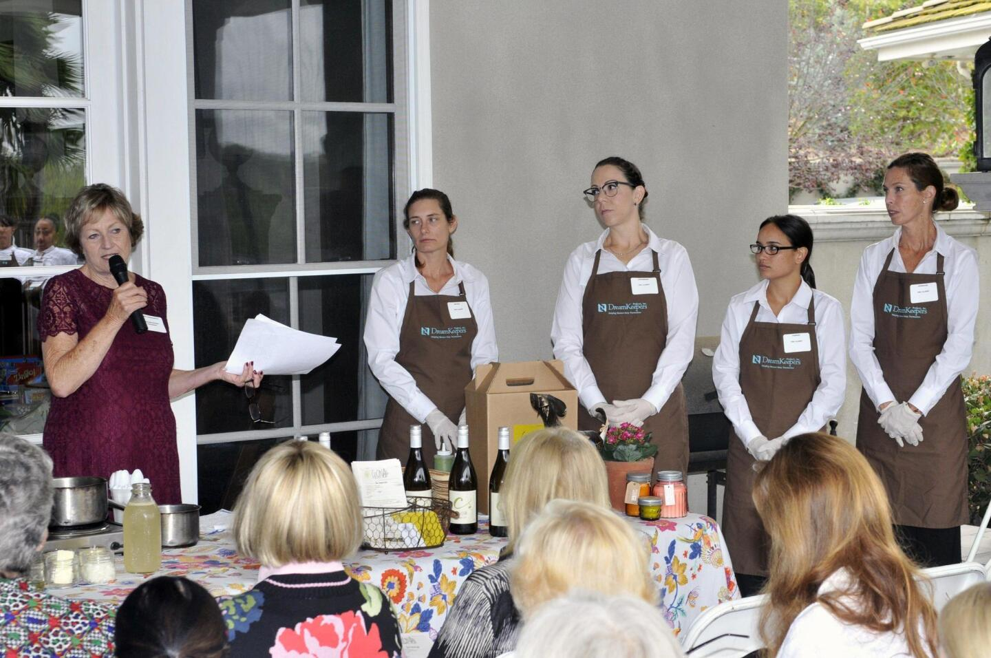 President Sandi Chenoweth welcomes the group to the cooking demonstration