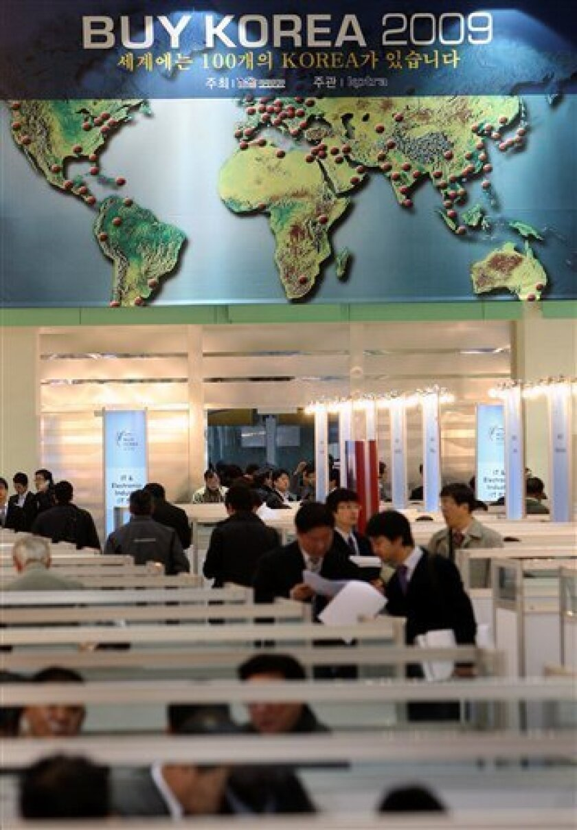 South Korean companies' employees talk with foreign buyers during an Export Fair Buy Korea 2009, in Seoul, South Korea, Wednesday, Jan. 14, 2009. South Korea's unemployment rate rose in December for the second straight month, the government said Wednesday, as the economy shed jobs for the first tim