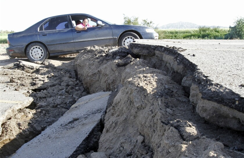 A passenger snaps a photo of a huge crack in the road a few miles from the epicenter of a 7.2 earthquake that struck Mexico's Baja California peninsula on April 4, 2010.