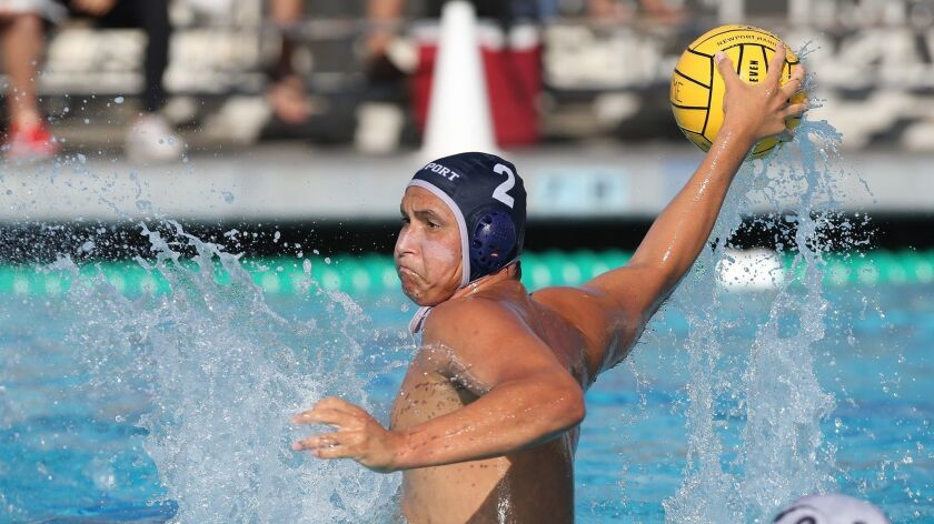 Newport Harbor's Makoto Kenney takes a shot in front of the net during boys' non-league water polo m