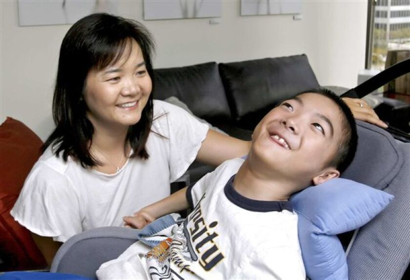 Nancy Leung, 40 of Pacific Palisades, with her son Aidan Leung, 8, at their attorney's office in Century City on Tuesday, April 12, 2011. (Raul Roa/Staff Photographer)