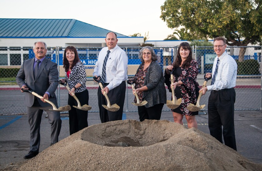 From left, Ramona Unified School District board member Bob Stoody, Superintendent Theresa Grace, Ramona High Principal Tony Newman, and board members Kim Lasley, Dawn Perfect and Rodger Dohm broke ground for the start of the solar panel (parking shade structure) installation project.