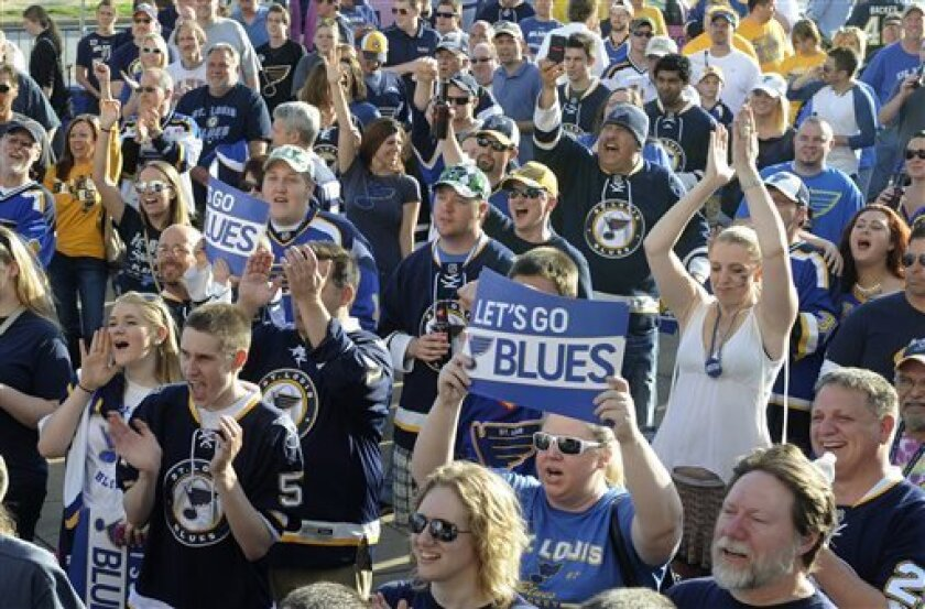 St. Louis Blues fans cheer prior to Game 1 of the Blues' first-round NHL hockey Stanley Cup playoff series against the Los Angeles Kings, Tuesday, April 30, 2013, in St. Louis. (AP Photo/Bill Boyce)