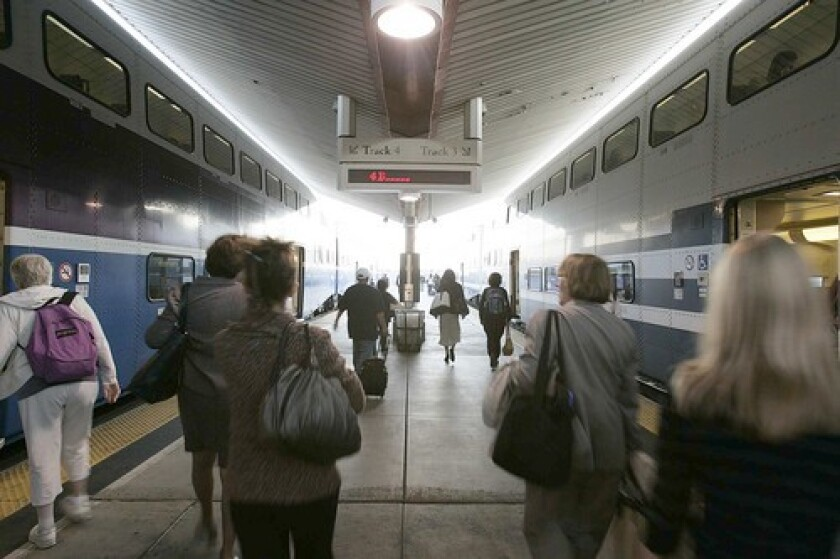 Passengers board trains at Union Station. Many of Metrolink's board members rely on reports from staff to stay informed of riders' concerns.