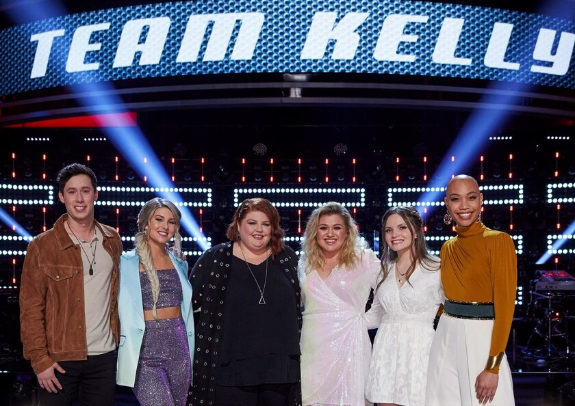 "Cedrice, far right, ended up on ""The Voice"" team of Kelly Clarkson, third from right, who has invited the La Mesa singer to join her on the stage in Las Vegas."