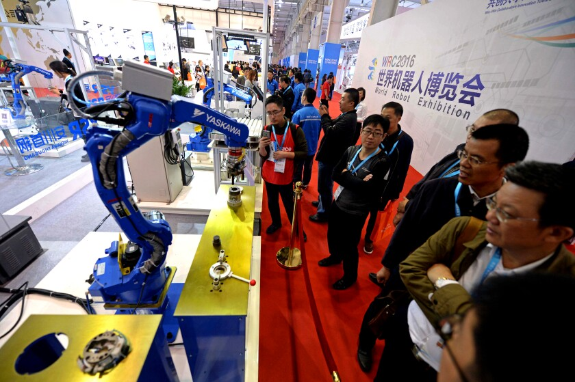 A Yaskawa robot performs at the 2016 World Robot Conference in Beijing.