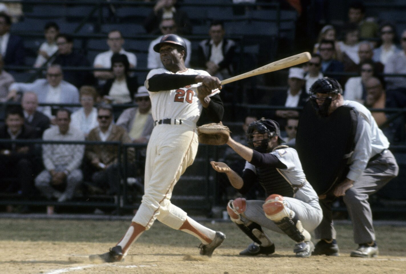 Baltimore Orioles' Frank Robinson watches the flight of his ball during a game at Memorial Stadium in Baltimore, Maryland.