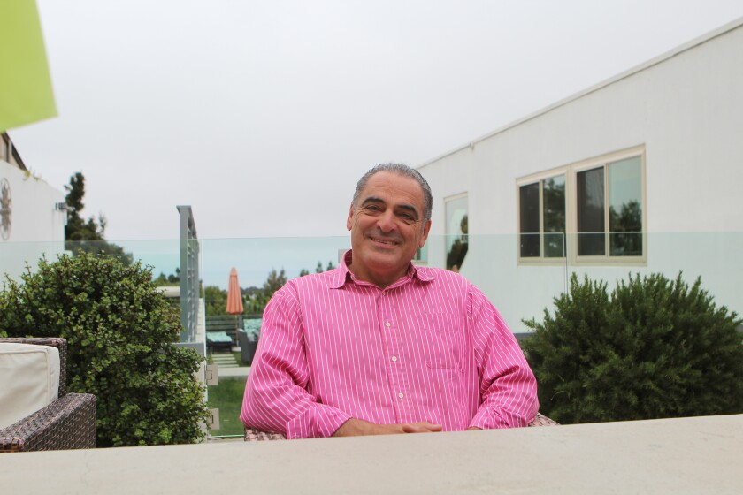 La Jolla resident Said Dawlabani, photographed in the backyard of his Mt. Soledad home, is a retired commercial real-estate broker who writes respected books about the global economy.