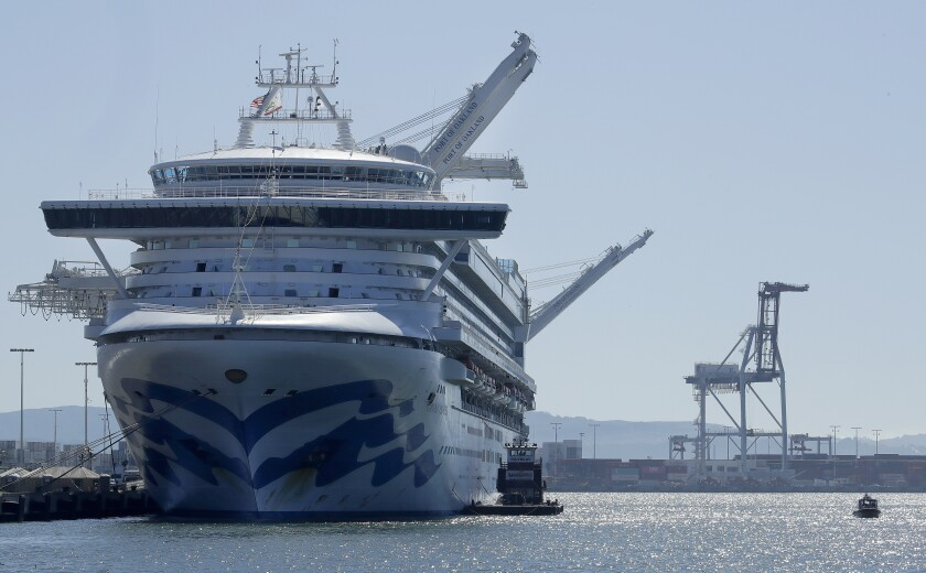 The Grand Princess cruise ship is shown docked at the Port of Oakland Thursday, March 12, 2020, in Oakland, Calif. California Gov. Gavin Newsom says nearly 500 passengers remain aboard the cruise ship. In addition to the 21 people who previously tested positive while aboard, Newsom says at least two more people have tested positive after leaving. For most people, the new coronavirus causes only mild or moderate symptoms. For some it can cause more severe illness. (AP Photo/Ben Margot)