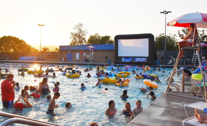 Powegians gather to watch a free movie in the Poway Swim Center pool in 2017.