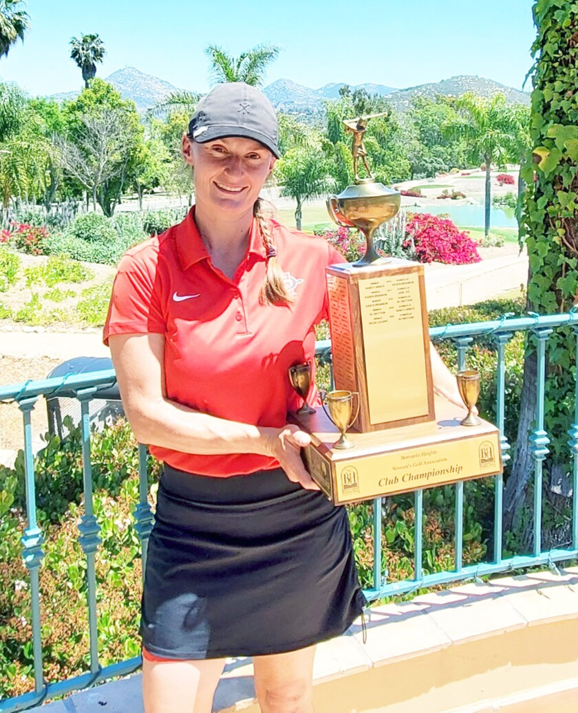 Basia Casara holding the trophy after winning the women's golf championship at Bernardo Heights Country Club on April 29.