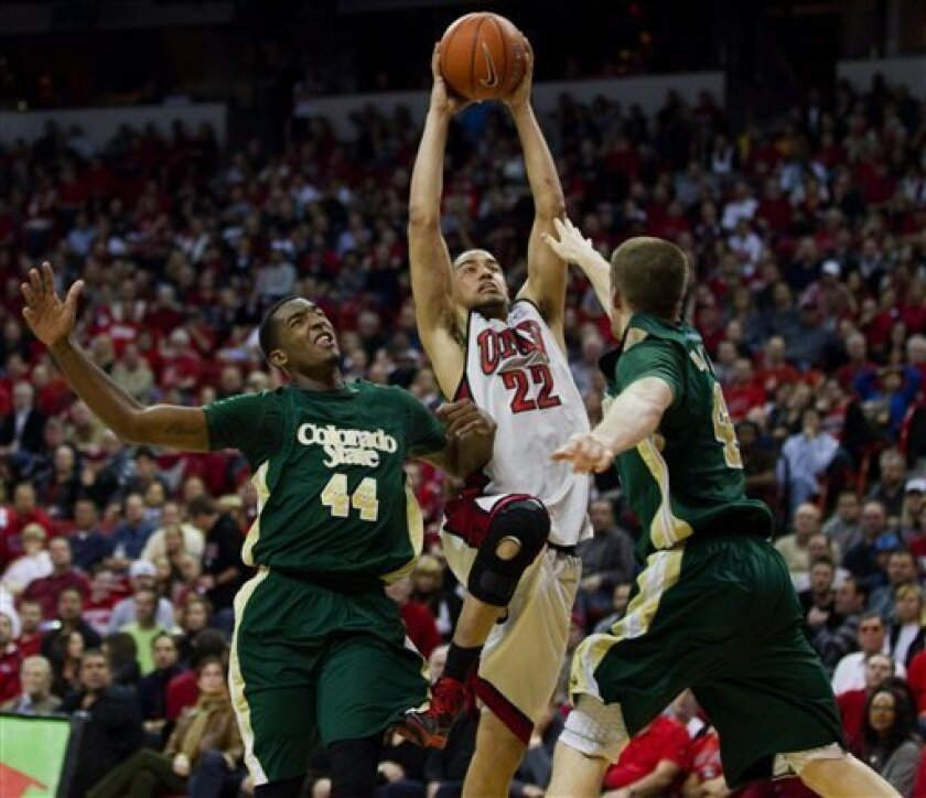 UNLV guard Chance Standback (22) drives to the basket while being defended by Colorado St. forwards Greg Smith (44) and Pierce Hornung (4) during their NCAA college basketball game wednesday, Feb. 1, 2012, in Las Vegas. UNLV defeated Colorado St. 82-63. (AP Photo/Eric Jamison)