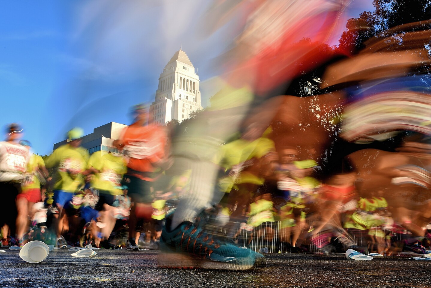LOS ANGELES, CA - FEBRUARY 14: Participants run near Los Angeles City Hall during the 2016 Skechers Performance Los Angeles Marathon on February 14, 2016 in Los Angeles, California. (Photo by Jonathan Moore/Getty Images) ** OUTS - ELSENT, FPG, CM - OUTS * NM, PH, VA if sourced by CT, LA or MoD **