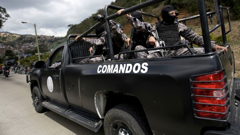 Members of the Venezuelan Bolivarian Intelligence Service arrive to the Junquito highway during an o