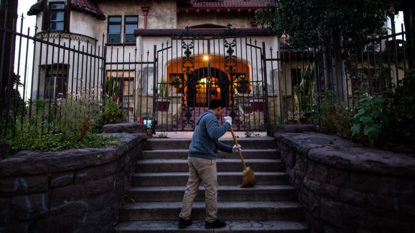 LOS ANGELES, CALIF. - MAY 16: Hildner Coronado Atjun sweeps the front stairs of Casa Libre on Thursd