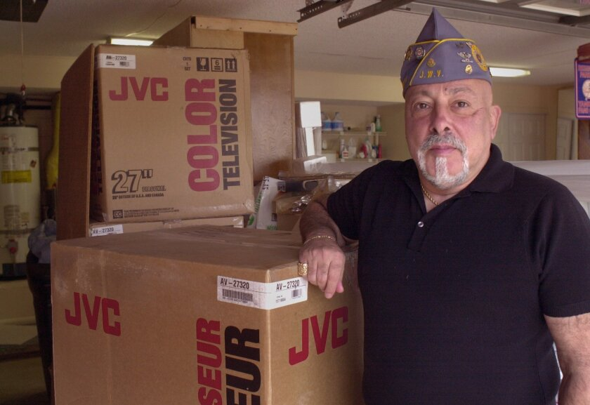 Col. Maxwell Colon back in 2003 standing in front of TVs the Jewish Veterans Group donated to the Naval Hospital, through their adopting Camp Pendleton program. UT/DON KOHLBAUER